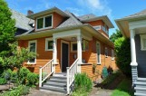 The side dormer blends seamlessly into this lovely Queen Anne home.